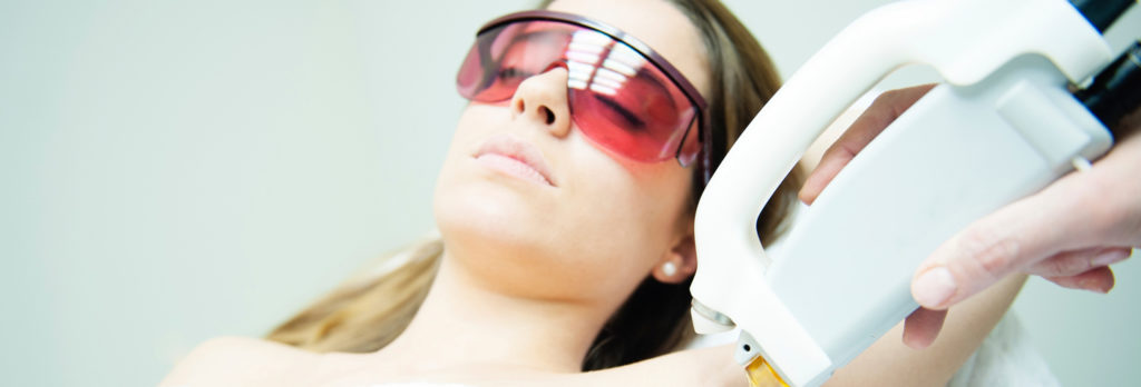 A woman is undergoing Laser Hair removal treatment in her armpit